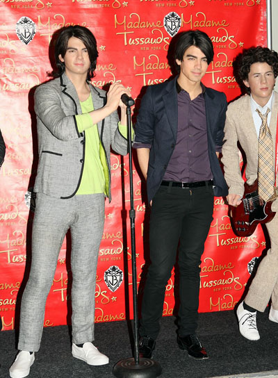 Joe Jonas from The Jonas Brothers and his wax figure in Madame Tusseudes museum in New York