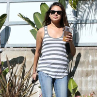Mila Kunis Pops Up Pregnancy Rumors