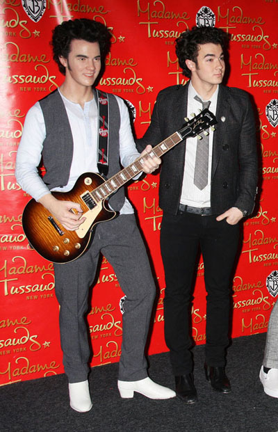 Kevin Jonas from the Jonas Brothers and his wax figure in Madame Tusseudes museum in NY