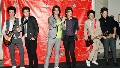 The Jonas Brothers present their wax figures in Madame Tussaudes museum in NY