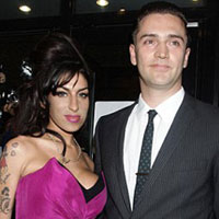 Amy Winehouse is back on the redcarpet with new boyfriend