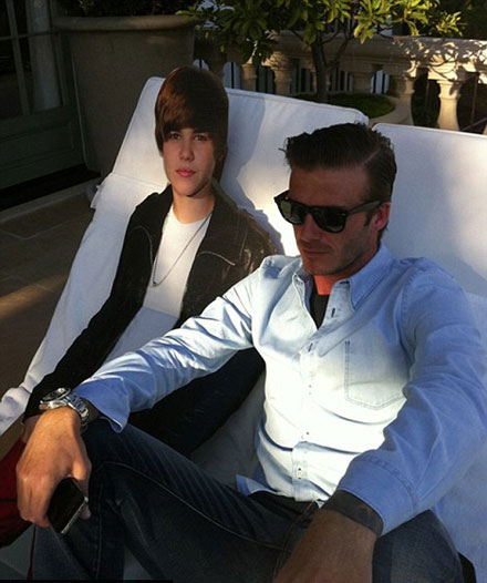 The Beckhams have the Bieber Fever - David Beckham is posing with Justin Bieber's cut-out