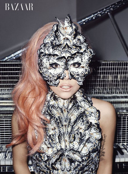 Lady GaGa is wearing a butterfly mask in Harper's Bazaar May 2011