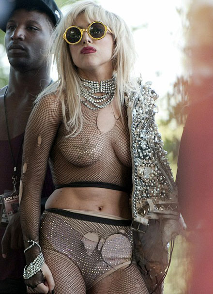 Lady GaGa goes exposed in the fishnet outfit and nipple caps