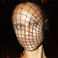 Tyra Banks channels Lady GaGa with a crazy fishnet mask at French Vogue 90th Anniversary Masquerade Party